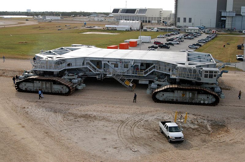 Crawler-transporter #2 beginning a road test on 21 December 2004. Image source: Crawler-Transporter.jpg by NASA (also NASA photo KSC-04PD-2683), licensed under Public Domain Mark 1.0.  See NASA media guidelines.