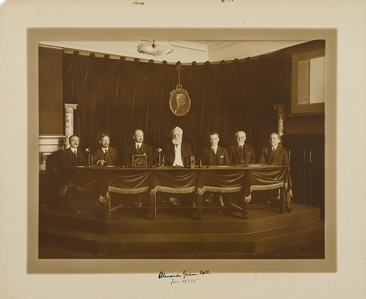 First transcontinental telephone call. Alexander Graham Bell (center), in New York City, 25 January 1915. Image source:  Alexander Graham Bell, first transcontinental phone call, 25 Jan 1915.jpg  by  Irving Underhill  Is licensed under  Public Domain Mark 1.0