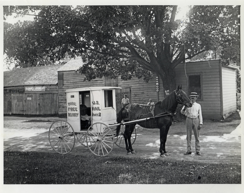 An unidentified rural carrier poses with his horse and wagon, Circa 1905. Image source: Rural Carrier with Horse and Wagon (also Flicker Commons) by unknown photographer; from Smithsonian Institution, National Postal Museum; has no known copyright restrictions, fair use