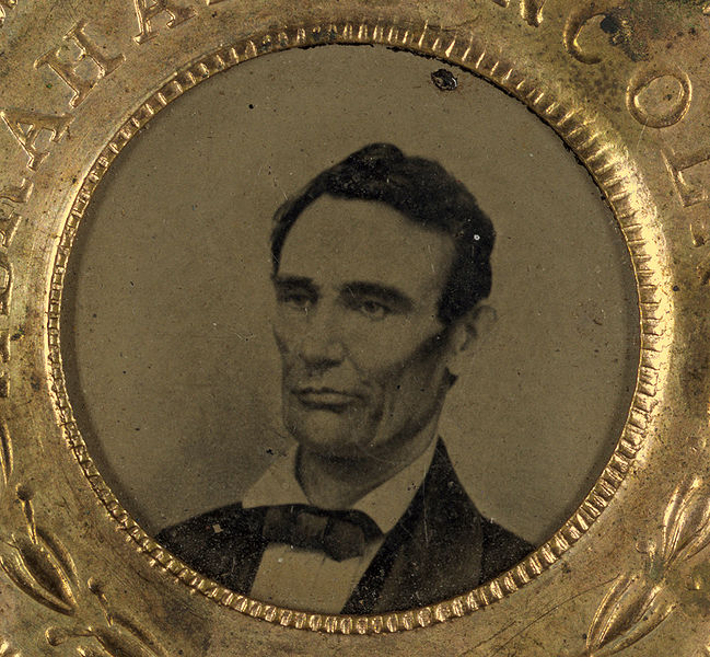 Campaign button for Abraham Lincoln, 1860. Portrait appears in tintype. Image source: Lincoln button 1860 small high contrast.jpg (originally derived from Library of Congress) by Mathew Brady is licensed under Public Domain Mark 1.0