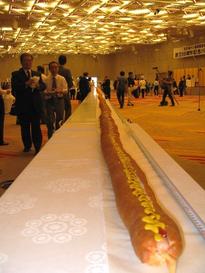 The world's longest hot dog (as of August 4, 2006), measuring 60.3 m, at the Akasaka Prince Hotel, Akasaka, Tokyo, Japan, on August 4, 2006. Image source: 60m Hot Dog Akasaka Aug4 06.jpeg by Tim Lindenschmidt is licensed under Public Domain Mark 1.0