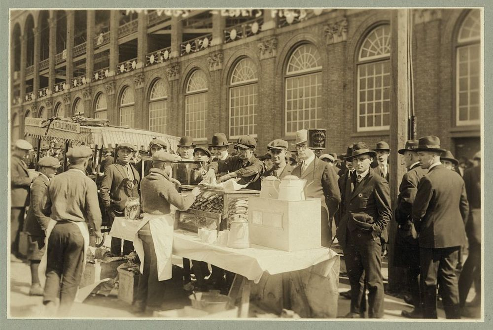 "Baseball fans--""Hot dogs"" for fans waiting for gates to open at Ebbets Field, Oct. 6, 1920. Image source: Library of Congress, Prints & Photographs Division,  LC-DIG-ppmsca-18463  from the  George Grantham Bain (1865–1944) collection  has  no known copyright restrictions"