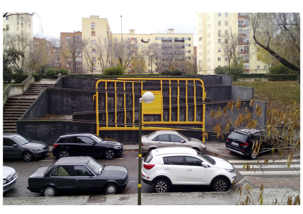 "PART 2: A massive yellow fence over a slope in Villaverde. This area is located in the south of Madrid, since it was part of Madrid its population has had to handle so many kind of ""fences"" everyday, most of them higher, stronger and less fancy than this one."