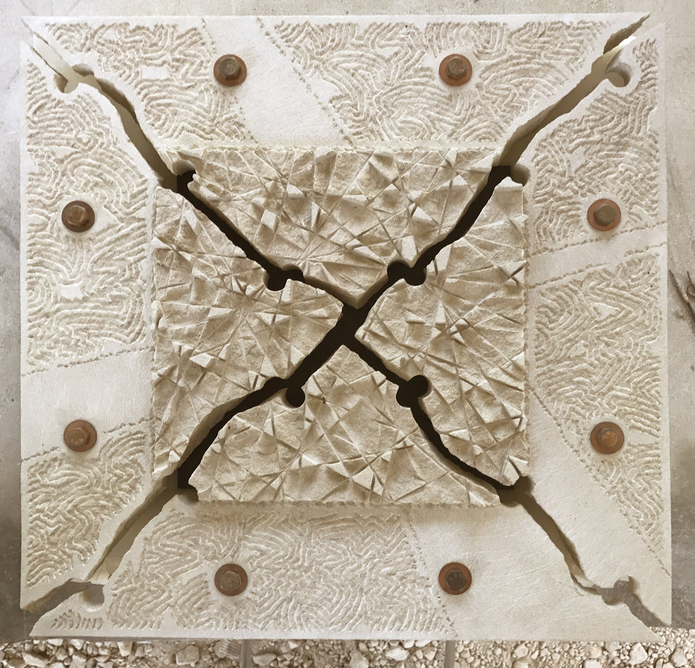 Limestone wall sculpture called The Center of a Mandala by Dale Enochs