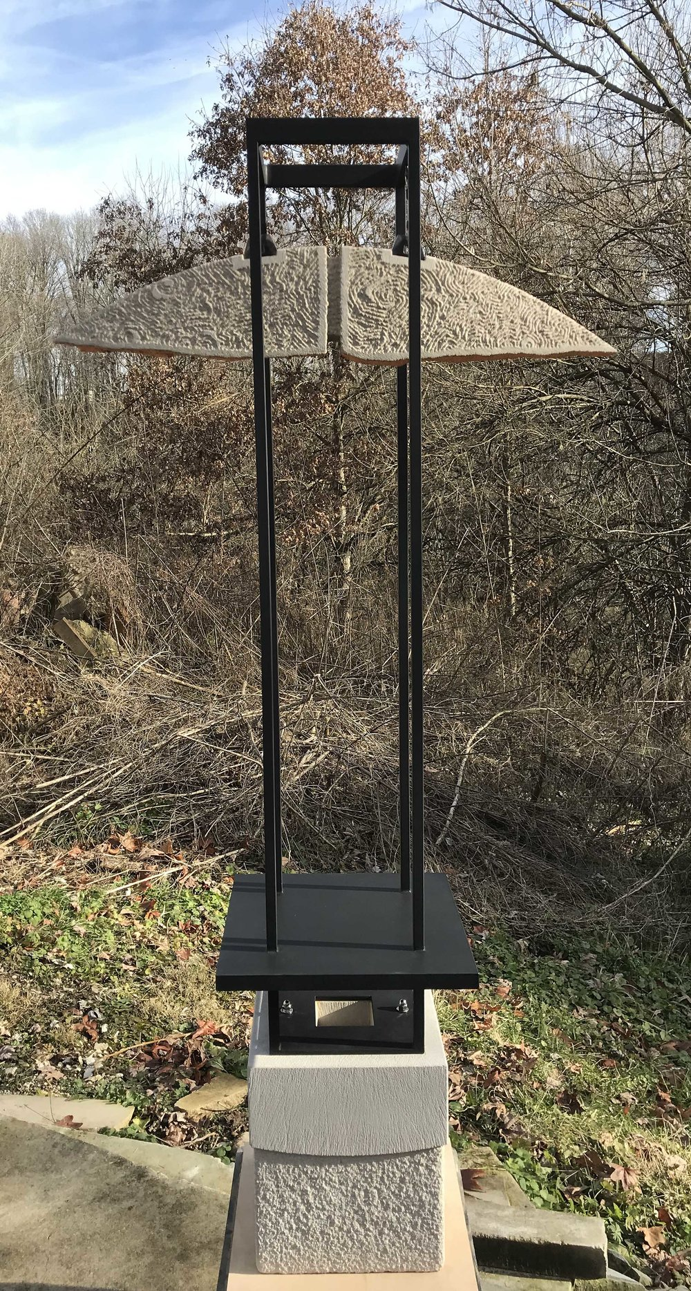 Free-standing limestone and steel sculpture called Full Circle by Dale Enochs