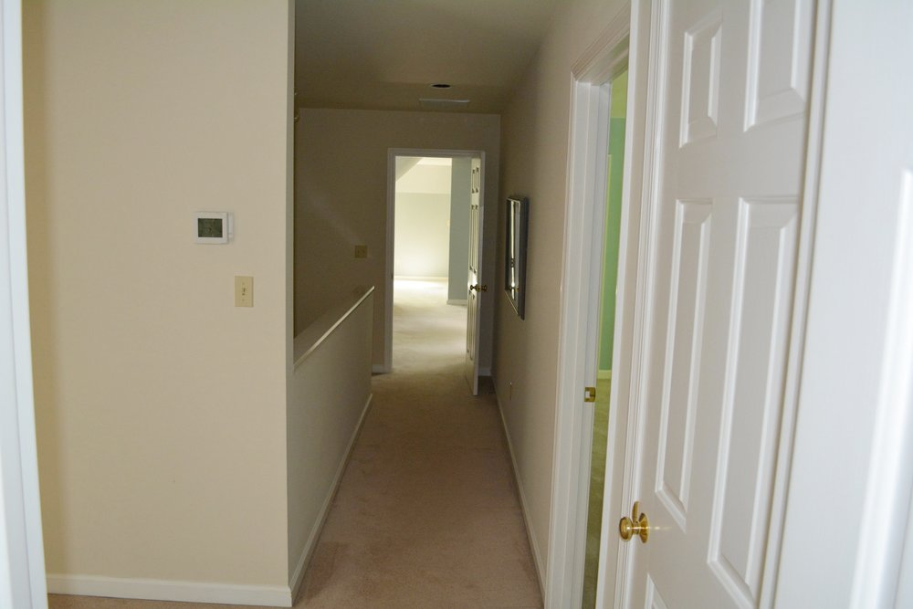 Hallway to foyer stairwell (to office & studio)