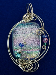 Christine Uttaro,  Serenity , 2014, dichroic glass, wire, beads