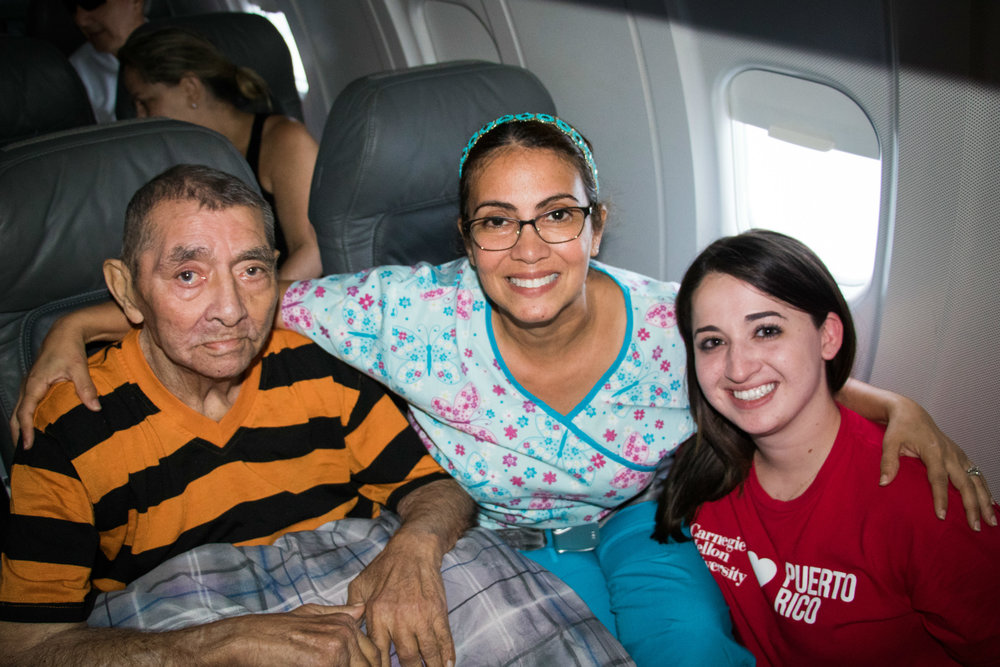 CMU student, Rosana Guernica (right), takes on Puerto Rico relief efforts by bringing supplies into the island and flying patients in need out for help. Photographed by José López Sánchez.