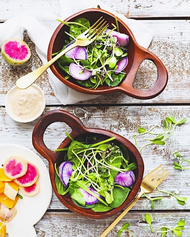 What a beautiful day! Finally some sunshine and breeze ☀️🌬 I'm spending part of the day at ceramics then the rest outside! But first making these salads today: spinach, arugula, sunflower shoots, purple daikons, and my special raspberry truffle tahini vinaigrette: -1 spoonful your favorite  mustard (I like Dijon or spicy mustard) -a few raspberries -1 spoonful tahini -1 spoonful nutritional yeast -splash of water -dash of truffle oil  In a small bowl, smash the raspberries. Mix in the mustard and tahini. Add some water to loosen the mixture. Stir in the nutritional yeast and truffle oil. If too loose add more nutritional yeast, if too thick add more water. Mix into the salad and enjoy!