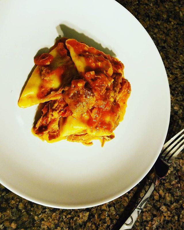 Braised pork shoulder with sausage ravioli pasta and sweet peppers and Portobello mushroom red sauce #divine 👌