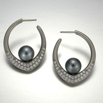 Metals:  18k White Gold   Diamonds:  .63tw   Pearls:  Two 8mm Tahitian