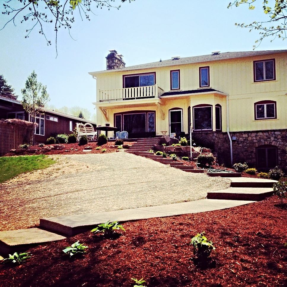 Photo credit: client  Exposed aggregate steps and patio leading to lake
