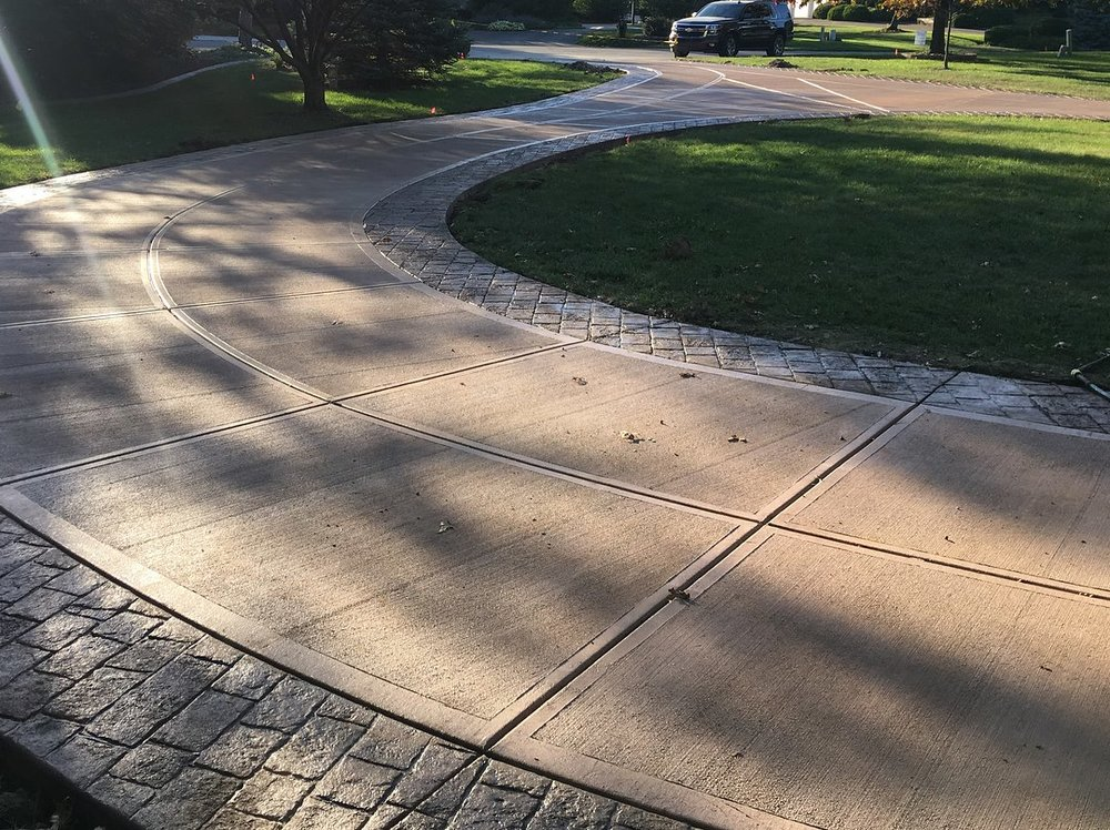 Photo credit: Will Mattingly  Integrally colored driveway with stamped borders