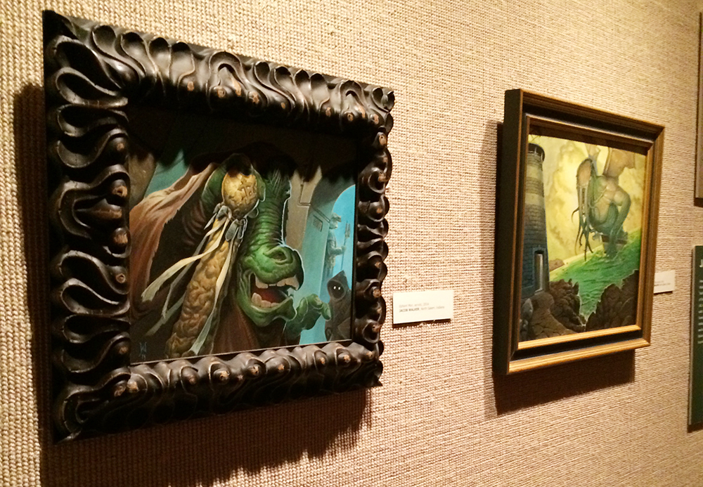 """Ephant Mon"" and Cthuhlu's Tide hanging in the EvansvilleMuseum of Arts, History and Science. The lighting looks so harsh in the photo."