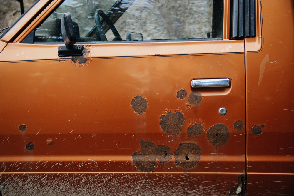 Bullet holes in Mark's old truck