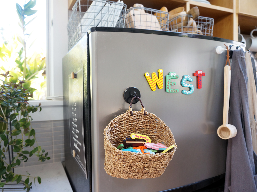 A Handmade  hanging basket  on A  magnetic hook  Holds west's magnetic letters and numbers on the fridge or dishwasher