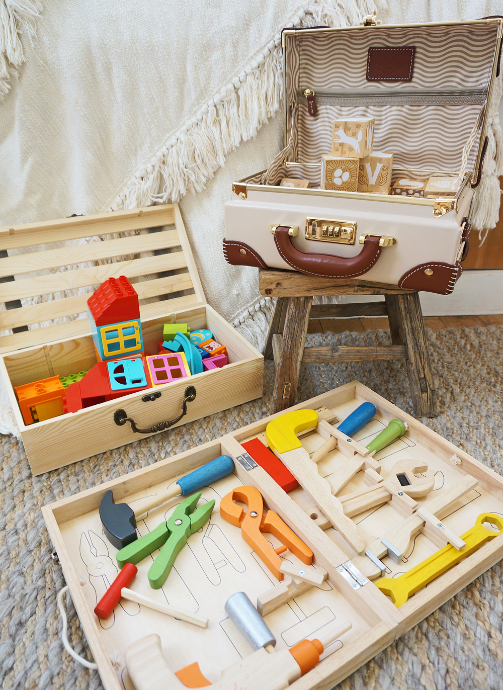 a mix of Toys contained via similarly-toned boxes and suitcases