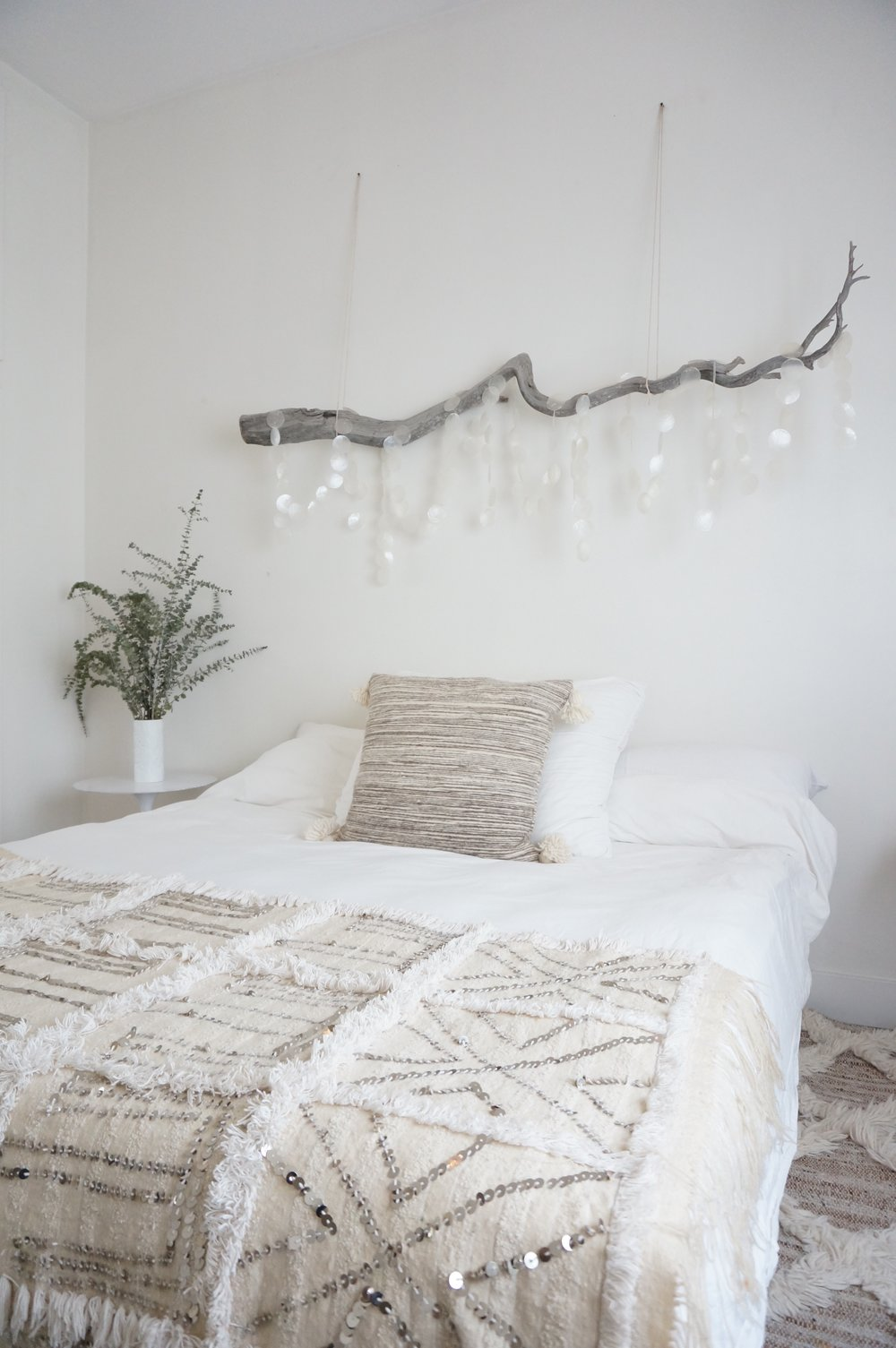 Above: My friend and neighbor Heather Tierney used a dried branch above her bed in lieu of a headboard or framed art. The draped capiz shells catch and reflect the sunlight in this Venice home.