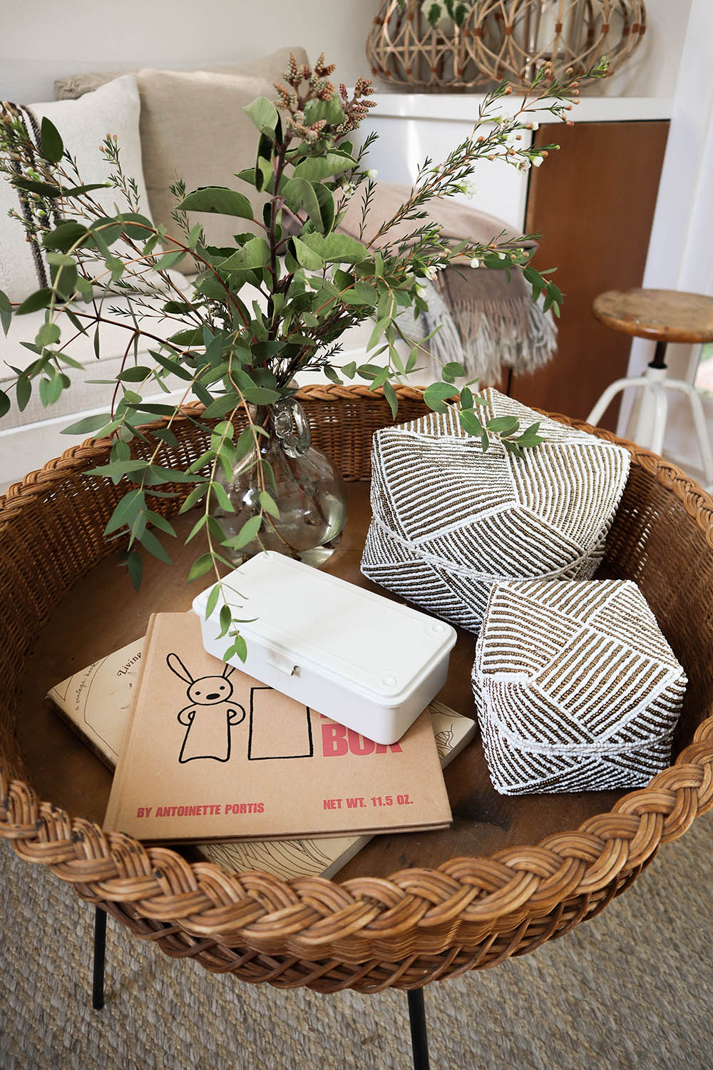 Above: Baskets from  Kembali collective , tin from muji. vintage coffee table from  super marché .