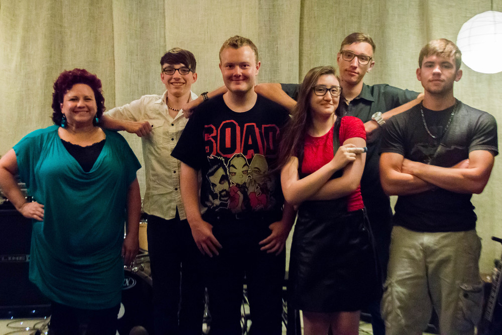 Pictured from left to right: Kathy McGuire, Vocal Coach; Phil Cruz, Singer/Guitarist; Cory Jones, Rhythm Guitarist; Taylor Benson, Bassist; PJ Cruz, Percussionist; Sam Ramos, Roadie
