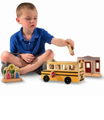 "My granddaughter, Baby M, loves playing with The Whittle World Wooden School Bus Set - no plastic! My daughter wanted her to play with a toy with wheels and one which both girls and boys would enjoy. I was amazed that most of the pictures of the toy were pictured with little boys, but Baby M certainly loves it. ""There's a friendly driver at the wheel & room for six happy passengers in this 10-piece wooden play set. With easy-rolling wheels & doors that open & close, this exciting set creates an interactive scene designed to inspire limitless play."" It even has a sturdy stop sign that flips out on the driver's side. Delightfully, the little passengers are multi-racial."
