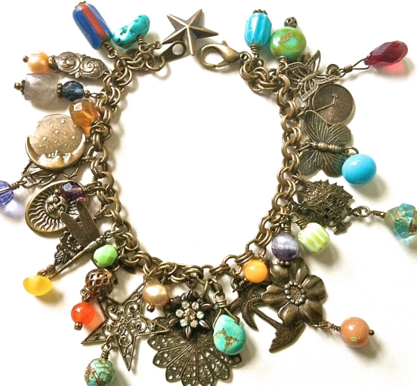 Antiqued brass charm bracelet with vintage beads, crystals, turquoise, trade beads charms, filigree...A gorgeous mixture of brass, vintage, crystal, pearl, and unique brass charms. All charm bracelets will vary slightly. Most vintage beads are one-of-a-kind, but they are all unique and beautiful @https://www.etsy.com/listing/99271117/antiqued-brass-charm-bracelet.