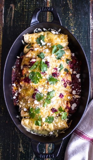 Brown Sugar Roasted Chicken Enchiladas w/Fire Roasted Tomatillo-Cranberry Sauce@http://www.halfbakedharvest.com/roasted-chicken-smoked-gouda-enchiladas-wfire-roasted-tomatillo-cranberry-sauce/