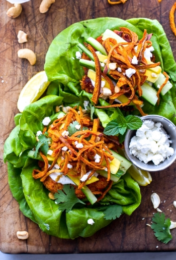 @http://www.halfbakedharvest.com/curried-salmon-burger-lettuce-wraps-wcrispy-sweet-potato-straws-goat-cheese/