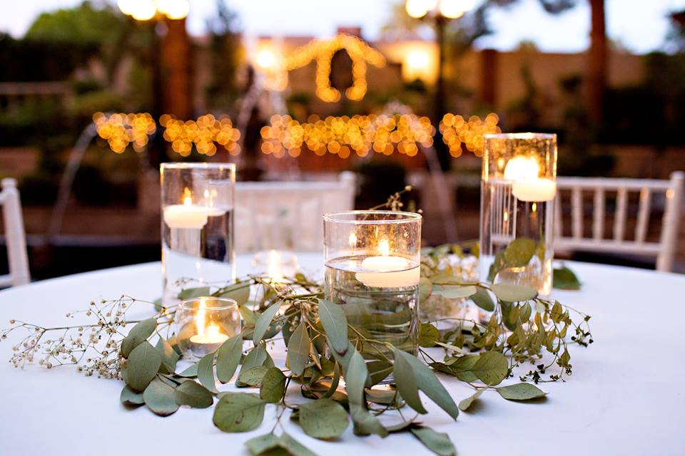 3 Round Cylinders - Were keeping it simple and embracing the greenery trend. A little candle light with a lot of greenery over a clean white linen is our number one pick!