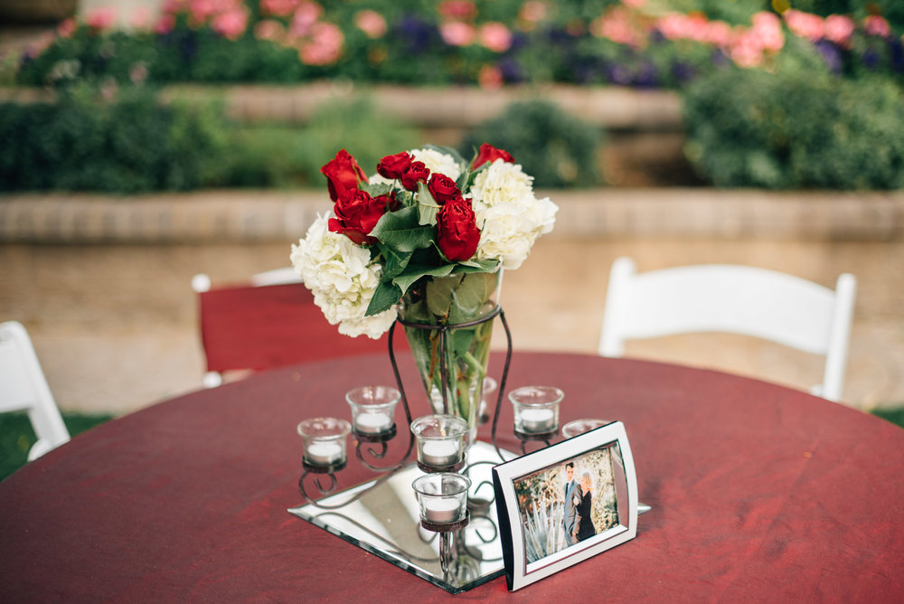 The DJ - This center piece is all about the romance, with 8 votive candles surrounding the clear floating vase it is perfect for adding ambiance lighting to the reception.