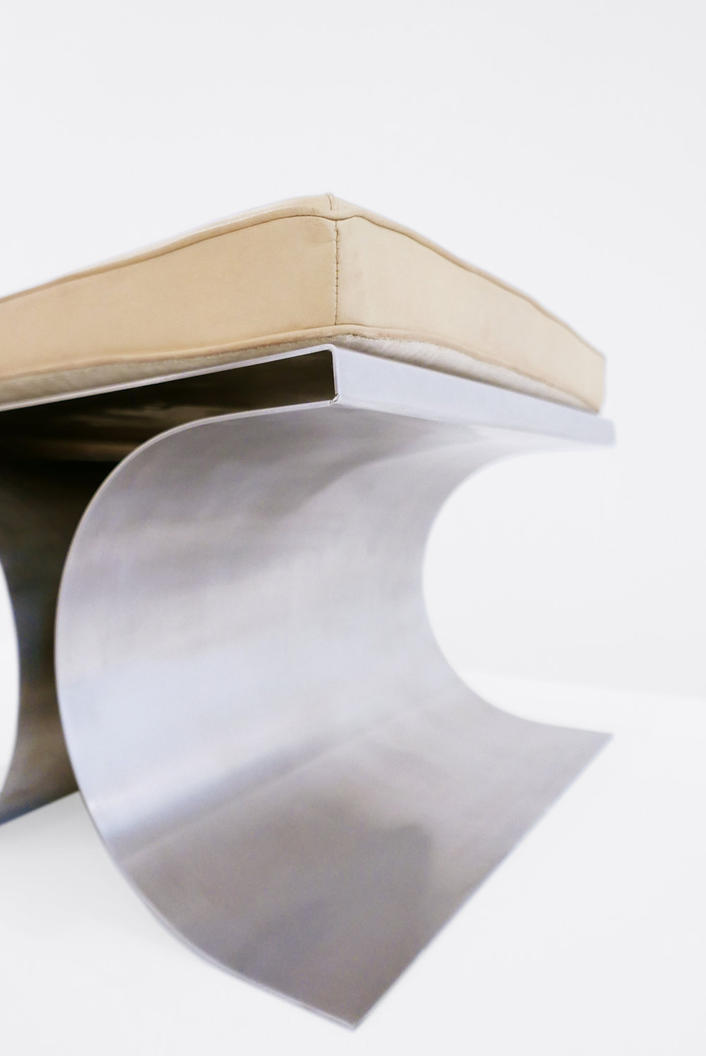6. Micel Boyer, 'X' Stool, c. 1968, stainless steel and leather upholstery, 16H x 19.75W x 19.75D inches.jpg