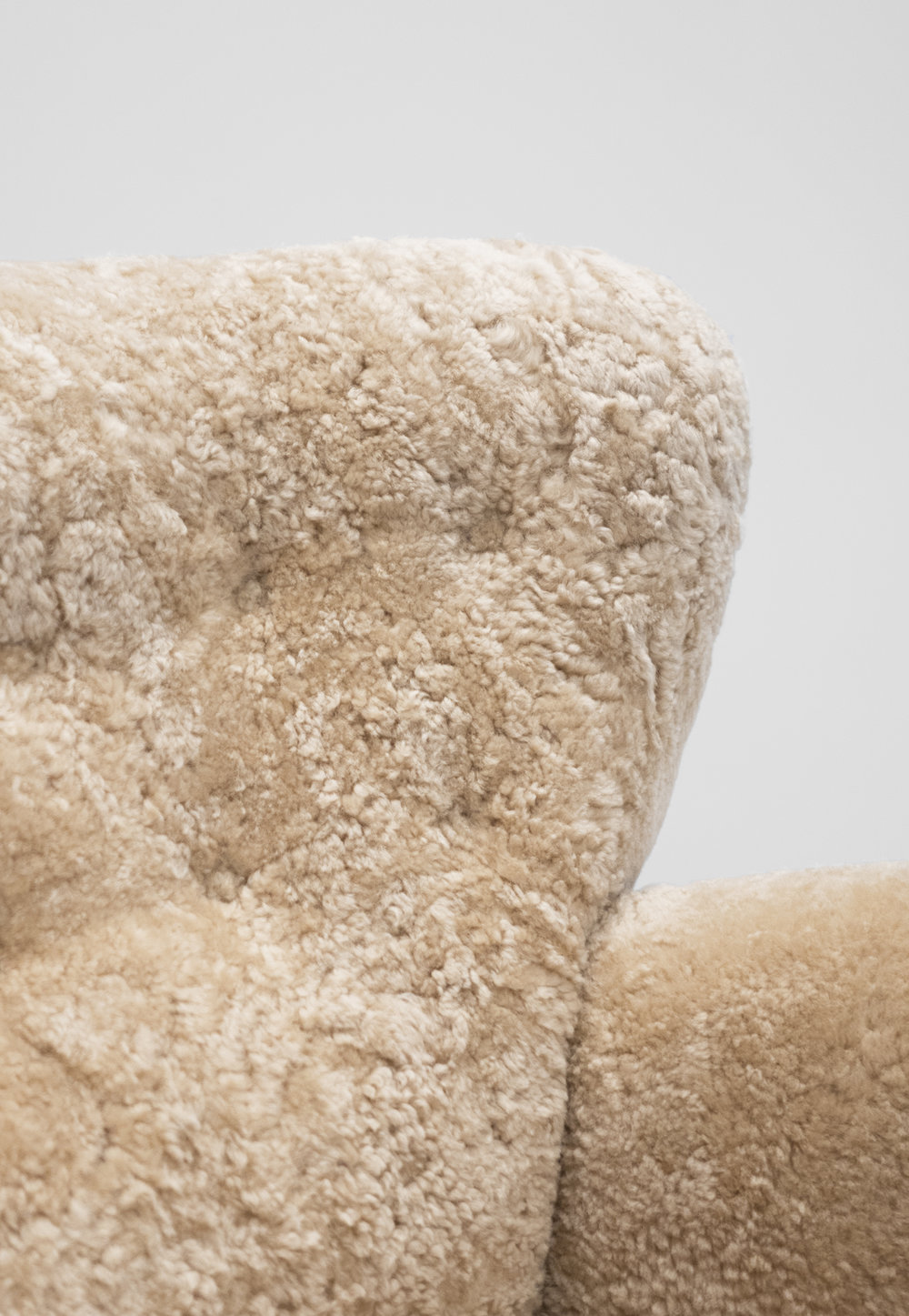 3. Mogens Lassen, attrib., Lounge Chair, c. 1940, sheepskin, stained oak, 40W x 39D x 36H inches.jpg