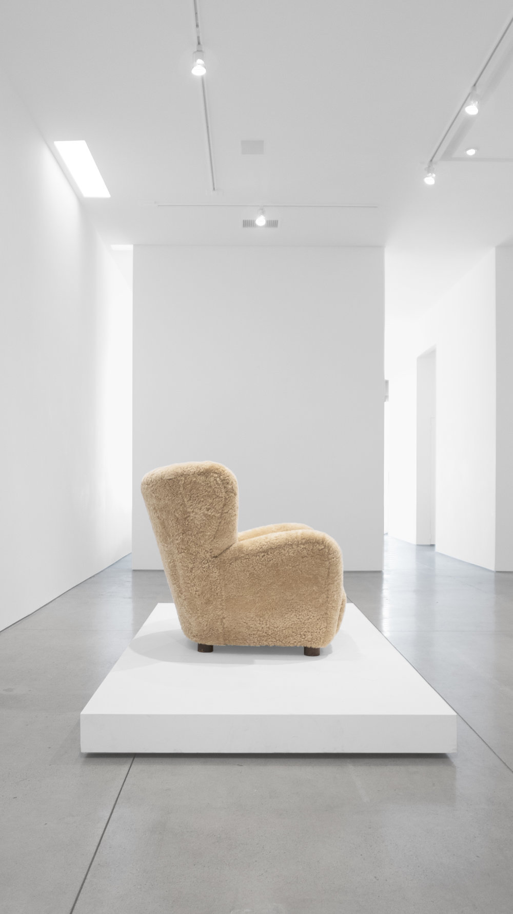 6. Mogens Lassen, attrib., Lounge Chair, c. 1940, sheepskin, stained oak, 40W x 39D x 36H inches.jpg