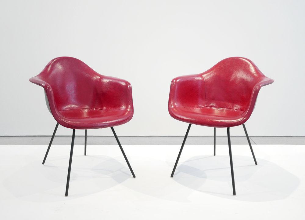 2. Ray and Charles Eames, 'DAX' Chairs, 1954, molded and lacquered fiberglass, vinyl, enameled steel, plastic, 31 x 25.5 x 25 inches.jpg