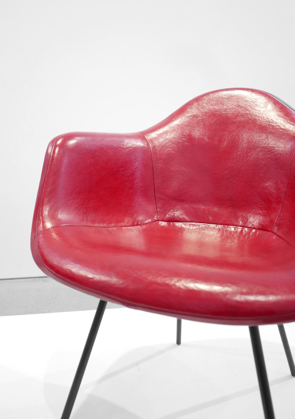 5. Ray and Charles Eames, 'DAX' Chairs, 1954, molded and lacquered fiberglass, vinyl, enameled steel, plastic, 31 x 25.5 x 25 inches.jpg