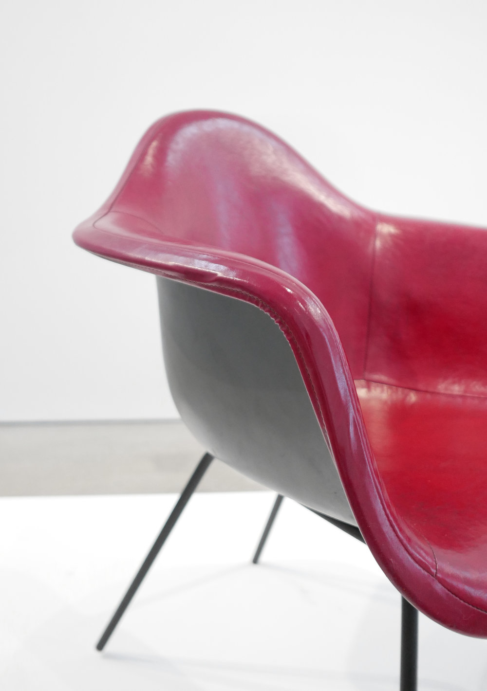 6. Ray and Charles Eames, 'DAX' Chairs, 1954, molded and lacquered fiberglass, vinyl, enameled steel, plastic, 31 x 25.5 x 25 inches.jpg