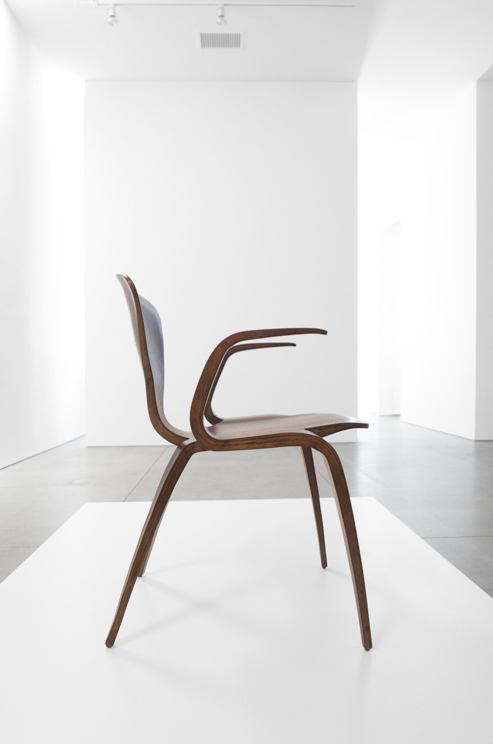 4. Norman Cherner, Rare Prototype Chair, c. 1950, walnut, 30.75H x 23W x 23D inches.jpg
