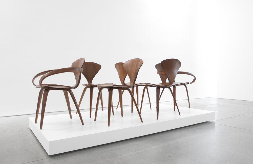 3. Norman Cherner, Pretzel Chairs, c. 1958, walnut, (4) 31H x 17W x 18.5 inches (2) 31H x 26W x 19D inches.jpg