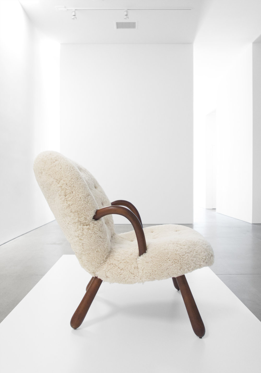 4. Philip Arctander, %22'Clam' Chair,%22 c. 1940s, birchm sheepskin, 32.5H x 26W x 32D inches.jpg