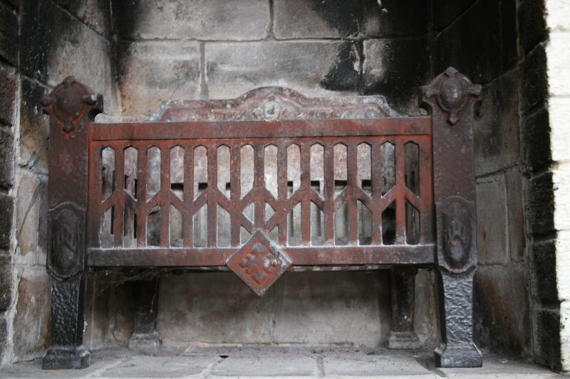 Our much-loved fireplace with cast-iron grate.