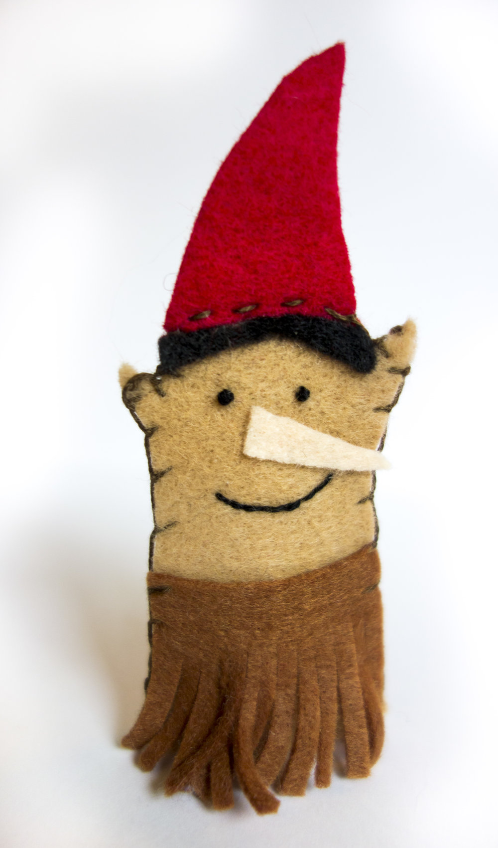 Wood Imp - I'll admit, this one's a fave. The body is tan with a beige nose, black hair, red cap, and brown skirt snipped partway up. I embroidered the mouth and did french knots for eyes.