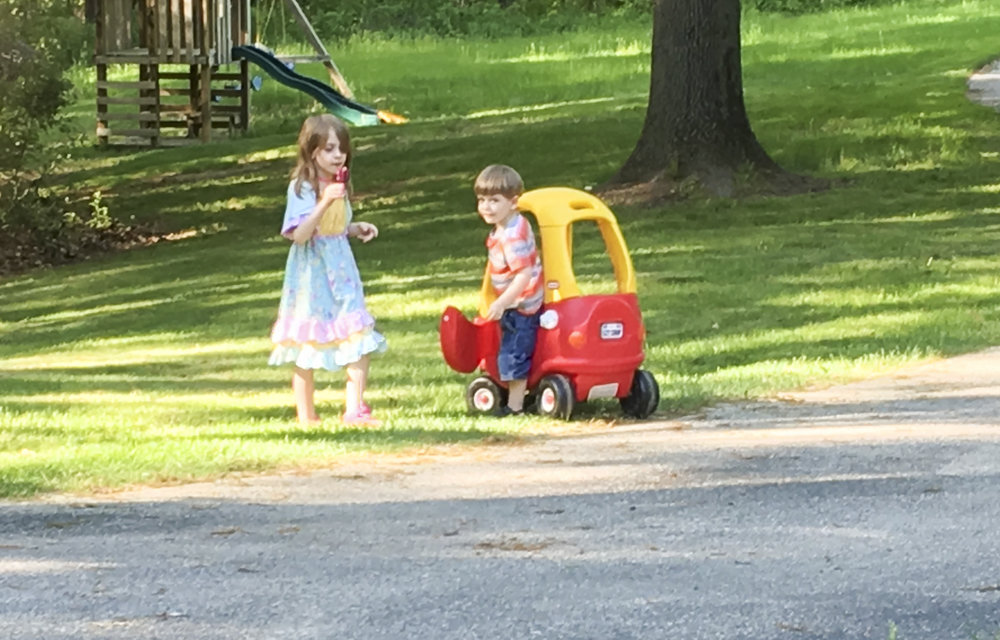 Penny and Kilian with their boy-eating car.