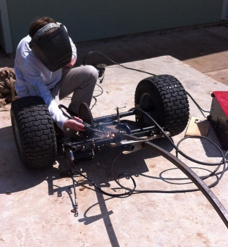 James converting a broken-down gasoline-powered go-kart into a three-wheeled electric vehicle.