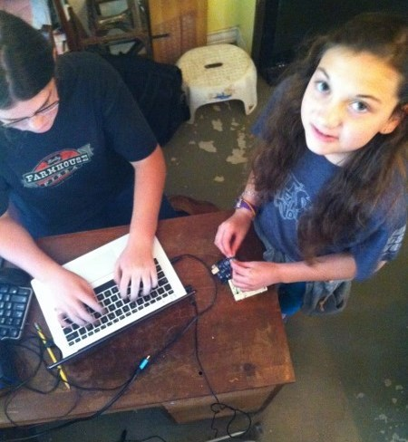 Beth and Sami getting some Arduino practice. They will build a gumball machine that releases candy only when you give the machine the correct secret knock.