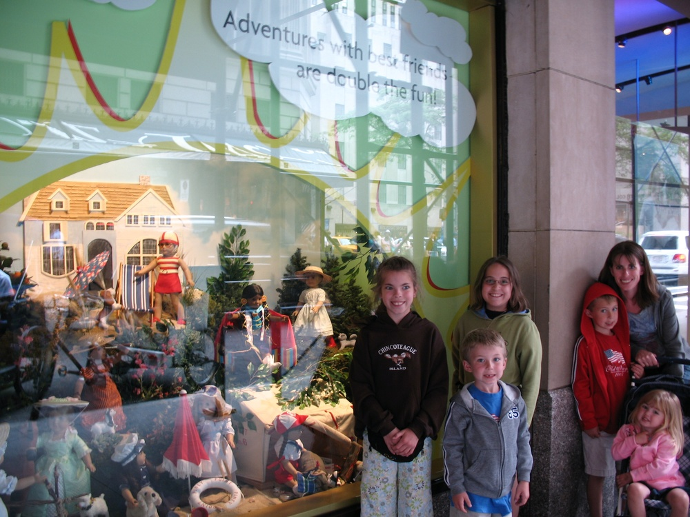 kelly and the kiddos at the american girl store in new york city--a quick detour on our trip up the coast