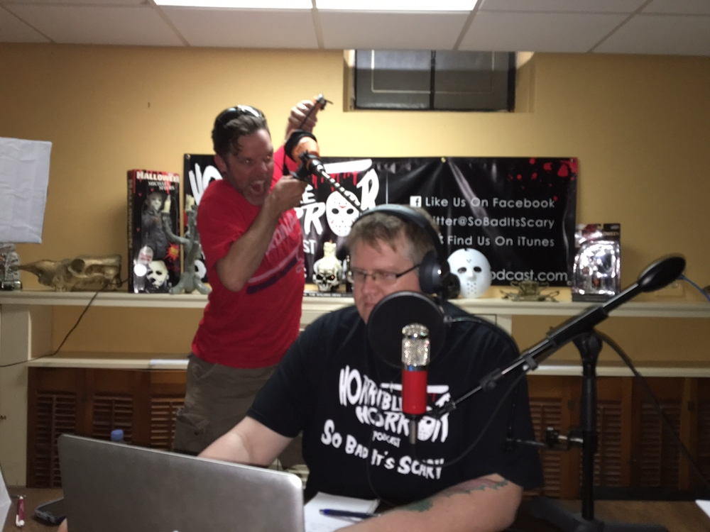 Chris Samples doing his best Russ Thorn impersonation while an unsuspecting Marshall edits the show.