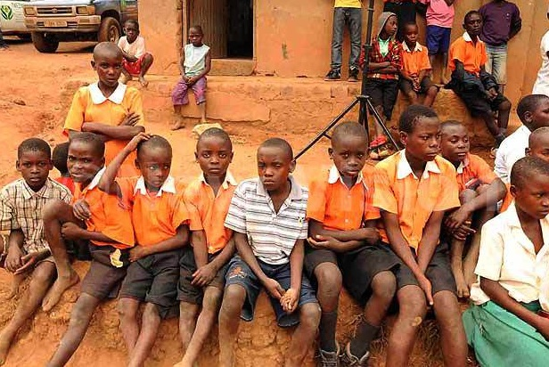 Malnourished and bare-footed primary school pupils of  Namabo, Kafumu Parish in Mpigi district