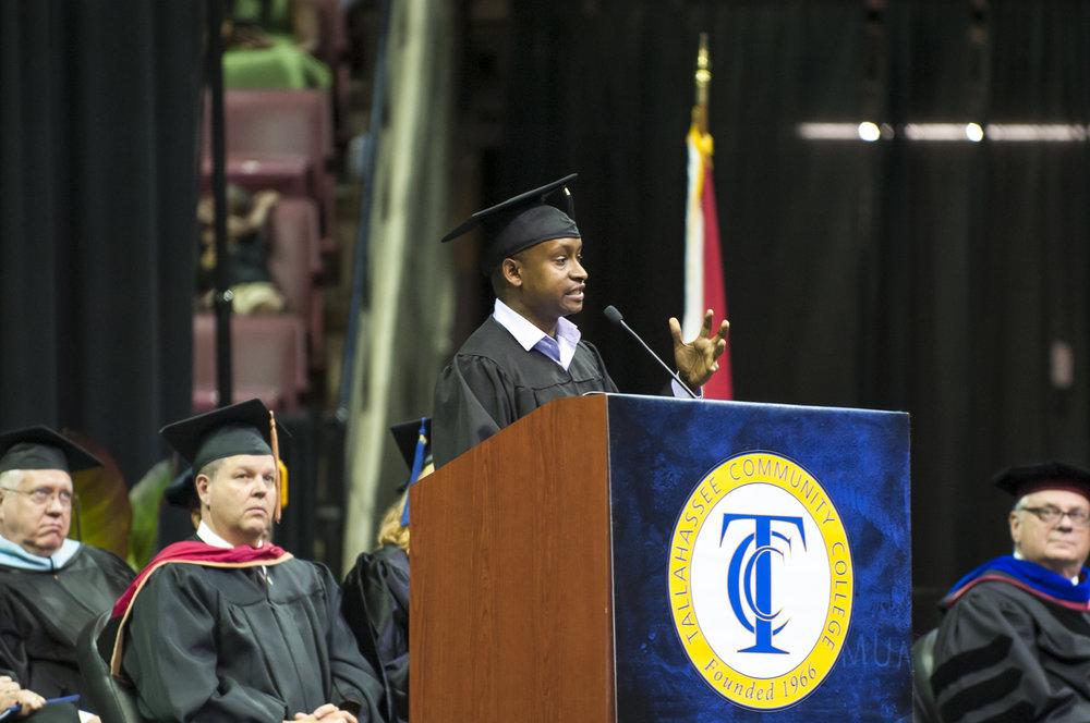 James Arinaitwe speaks to Graduates.jpg