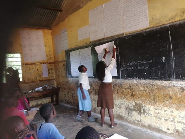 @teachforuganda Teacher- Molly showing the way to our kids. At Kasiiso C/U Primary School. When TFU fellows arrived in this community our children were 2 years behind on all aspects of their reading/writing, comprehension and arithmetic. Their confidence levels were almost zero. It's almost day and night hearing and witnessing the transformation in just 10 months of having TFU fellows as their teachers! Grateful to our partners, board and champions and supporters of TFU