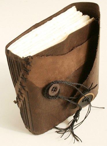 handmade, hand-bound leather journal. long stitch bound.